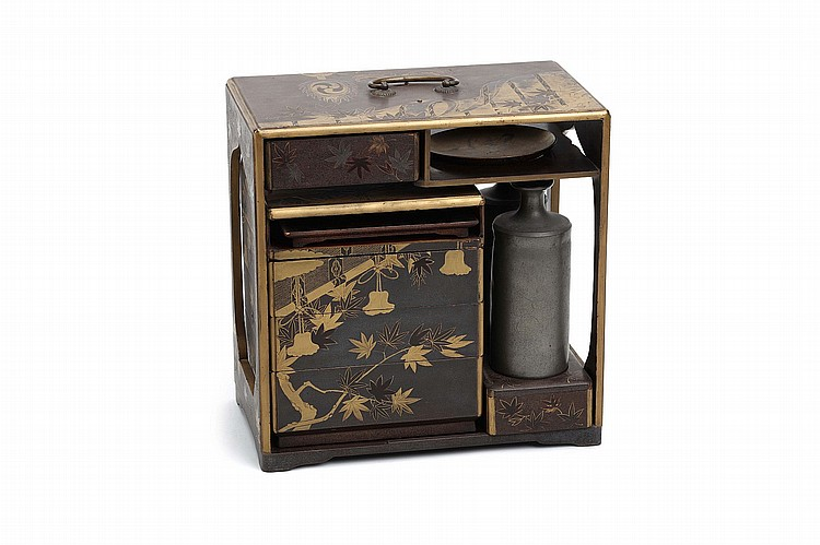 A LACQUER PICNIC BOX.   18th / 19th Century.   A Sage-Jubako, the rectangular frame enclosing four- tiered Jubako, a tray, a sake cup, two pewter sake bottles, and two drawers, decorated in gold hiramaki-e, with maple tree against bamboo blinds, 26 x 26 x 15cm.    ???????