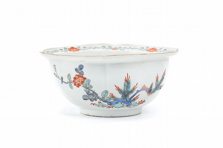 A KAKIEMON-STYLE BOWL AND AN IMARI JAR. Edo period or later. The first, a deep bowl of mokko-form, with brown-edged rim, decorated in iron-red, blue, green, yellow and black enamels with a roundel of two ho-o birds inside, the exterior with clumps of peonies and pine trees, prunes and bamboo, 9 cm H, 18cm diameter; the second, a small Imari jar of ovoid form, decorated in underglaze-blue and various enamels with chrysanthemums and butterflies, 15cm H. (2) ??????????????????????