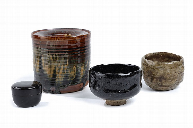 A GROUP OF TEA CEREMONY UTENSILS.   20th Century.   Comprising a black Raku tea bowl, a mizusashi with thick brown glaze, a black lacquer chaire, and another tea-bowl with green glaze, various sizes. (4).   ?????????????????????