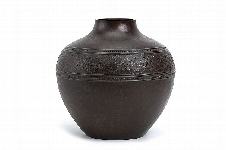 A LARGE BRONZE VASE BY TAKAMURA TOYOCHIKA (1890 – 1972)   20th century.   Of ovoid form, well cast with a horizontal band of studs enclosing arabesque motifs in dark brown patina imitating terracotta texture, with the seal mark Toyochika. 27cm H.   A son of the sculptor Takamura Koun, Toyochika received many prestigious awards for his fine metal casting work and became a 'Living National Treasure' in 1964.   ??????????????