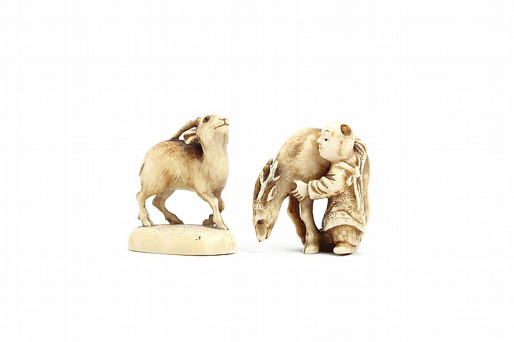 TWO IVORY NETSUKE. 19th Century. The first, a deer standing on an oval mound base, with its head slightly raised, inlaid eyes, signed Rantei, 4cm H, the second, a karako stroking the back of a standing horse, unsigned, 3.5cm H. ???????????????????