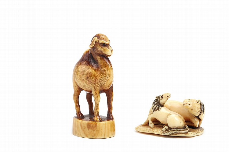 TWO IVORY NETSUKE. 19th Century. Comprising an ivory group of a horse and foal both recumbent side by side, signed Rantei, 3cm long, and a standing camel netsuke, well patinated and with inlaid eyes, unsigned, 5cm H. (2) ?????????????