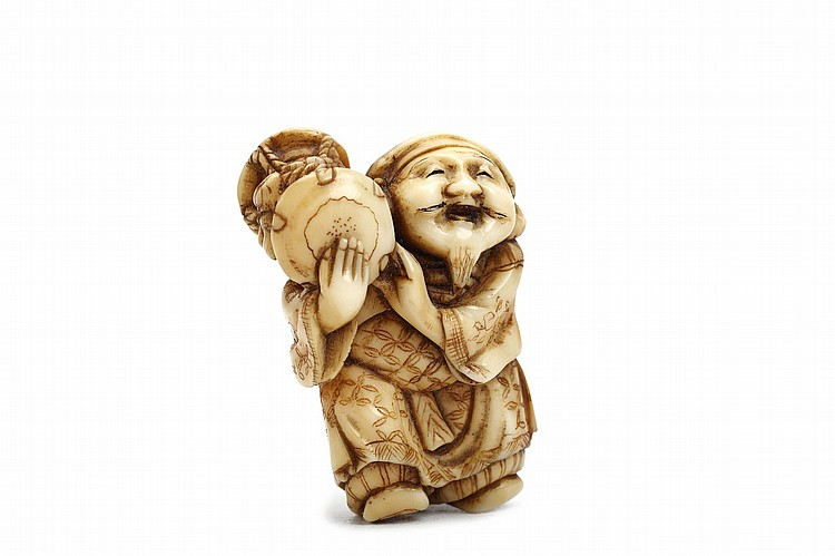 AN IVORY NETSUKE OF A DANCER.   19th / 20th Century   A sanbaso dancer, standing with one leg slightly raised, holding his drum on his shoulder, his kimono and a head scarf engraved and stained with patterns, unsigned, 4cm H.   ?????????????????