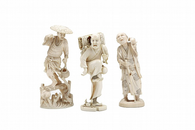 THREE IVORY FIGURES.   Meiji period.   Comprising a fisherman walking on a wood plank bridge, surprised by a kappa appearing from the water, signed Mitsumasa, 15cm H; a man stepped on a crab which escaped from his basket on his shoulders, signed Gyokumin, 15cm H and an old man supported by a stick, with his left arm bending over his shoulder about to throw something, unsigned, 16cm H.   ?????????????