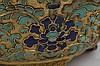 A PAIR OF CHINESE GILT BRONZE CHAMPLEVÉ ENAMEL JARDINÈRES.   Qing Dynasty, Qianlong period.   With four bracketed lobes, terminating in an everted flanged rim, decorated in the champlevé technique with lapis blue and turquoise enamels with leafy lotus blossom, the edge of the rim chased with key fret, four foot stands, ring handles suspended from leafy flower twin handles, original liners, 11cm H. (2)   Provenance: Collection of Mr (1926 –) and Mrs Chen (1930 –).   ? ?? ???????????