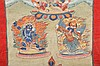 A THANGKA DEPICTING HAYAGRIVA, VAJRAPANI AND GARUDA.   Tibet, 19th Century.   The upper register containing a wrathful Red Hayagriva depicted in dharmapala form, the lower register with Vajrapani on the left and the Bird King on the right, pigments on cotton, mounted in Chinese silk textiles, retaining the original rolling rod, the painting 37cm x 24cm.   19?? ??????