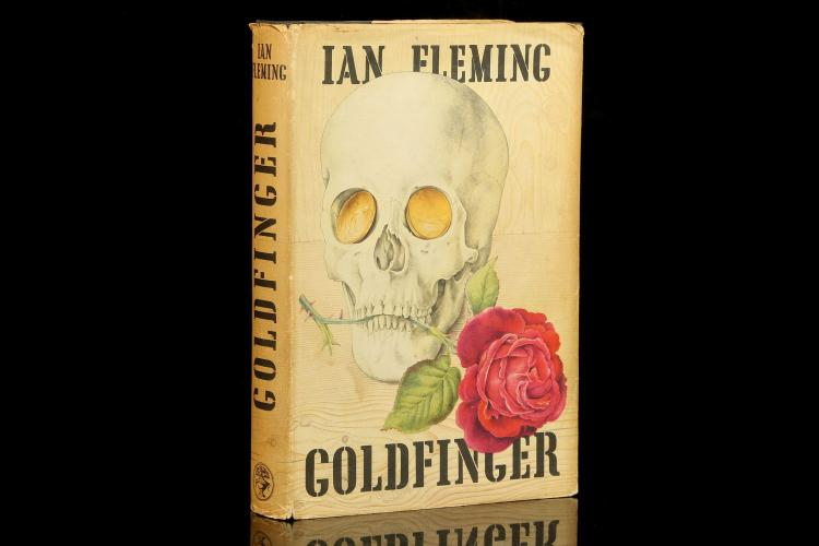 FLEMING, Ian (1908-64). Goldfinger. London: Jonathan Cape, 1959. 8vo. Publisher's black pictorial cloth, gilt with yellow/white/red pictorial dust-jacket, designed by Richard Chopping (chipped, lightly soiled/browned). Provenance: F. Wade (signature). FIRST EDITION.