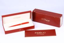 DUPONT FIDÉLIO PEN     A Dupont Fidélio ball point pen, presented in the coral finish option with gold plated collar and shirt clip.  Boxed together with papers and refills.