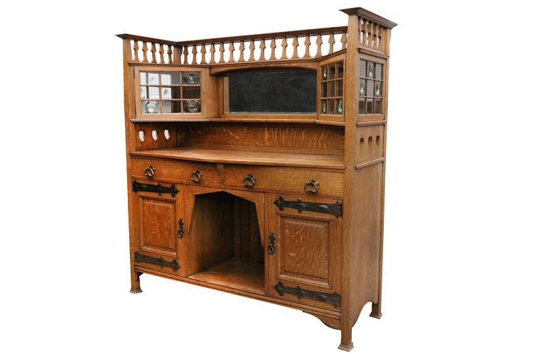 An oak Arts & Crafts sideboard dresser, circa 1910