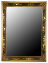 A rectangular Chinoiserie lacquer wall mirror, circa 1920, in black and gold, the rectangular bevelled plate within a figural trellis border, 72cm high