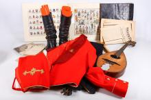 A small selection of items of military interest, to include a full dress part uniform, a Royal Scots style red jack by Gieves & Hawkes of Saville Row, a pair of black leather boots, a coloured print of uniforms of regiments of the British Army - past and present, official crests of the Royal Navy, also with some paperwork, and a Nenes Deutschland newspaper of 1953 showing Stalin (Qty)