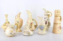A good collection of Royal Worcester 'Blush Ivory' porcelain, late 19th and early 20th Century, decorated with flower sprays in vertical shapes, enriched with gilt and scrolling foliage, comprising seven ewers and one twin-handled vase, the tallest 23cm high (8)
