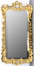 A George II style giltwood and gesso wall mirror, early 20th Century, the shaped bevelled rectangular plate within a pierced scroll and floral frame, 120cm high