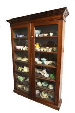 A Victorian oak glazed bookcase, 19th Century, with two full glazed doors, five movable shelves and a pediment, with key, 214cm high x 152cm wide, pediment 38cm deep