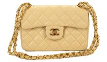 CHANEL SMALL BEIGE SINGLE FLAP HANDBAG, early 1980s pre-serialisation, gilt tone hardware, 21cm wide, 15cm high, with dust bag