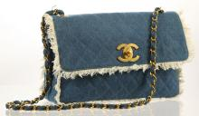 CHANEL MAXI FRINGED DENIM FLAP BAG, date code for 1991/93, light blue quilted denim with white fringe edges, gilt metal hardware, 34cm wide, 24cm high