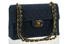 CHANEL MAXI DENIM FLAP BAG, date code for 1989/91, dark blue quilted denim and gilt tone hardware, 34cm wide, 24cm high, with dust bag