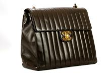 CHANEL DARK BROWN JUMBO FLAP BAG, date code for 1995, vertically quilted lambskin and gilt hardware, with authenticity sticker and card, 33cm wide, 23cm high, with dust bag and box
