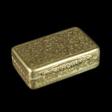 A 19th Century gold snuff box, unmarked, with scroll engraving throughout and floral thumbpiece, 4.5cm wide, approximately 45gm