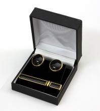 A pair of Montblanc cufflinks, each with a circular onyx cabochon to an 18ct gold mount and the matching tie pin