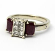 A ruby and diamond dress ring, the centre set six brilliant cut diamonds within a rectangular setting, flanked by two step cut rubies, to a stamped 14K white gold setting, size N