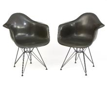 Charles and Ray Eames for Herman Miller, two DAR chairs in grey, each with moulded seat on Eiffel Tower metal frame, label for Herman Miller to underside of both