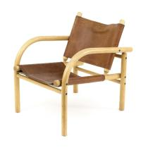 A 20th Century beechwood open armchair, with brown leather slung seat and back
