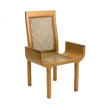 John Makepeace (British, born 1939), a tan leather covered armchair, circa 1970, the beech frame with inset cane panelled back and seat, raised curved arms and square legs, the frame stamped John Makepeace and bearing label for The Attlee Foundation