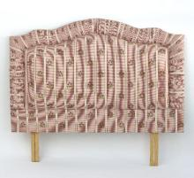 A headboard for a double bed, upholstered in check and floral design, 53cm wide and a woven blanket