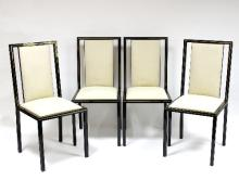 Pierre Vandel (French), a set of four black and gilt aluminium framed dining chairs with cream upholstered seats and backs