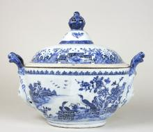 A 19th Century Nankin blue and white oval tureen with shaped mask head handles (one damaged), the cover with pierced finial, 37cm wide overall