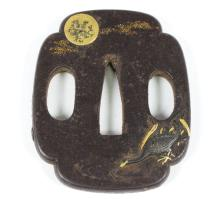 An 18th Century iron tsuba, possibly Nara School, decorated a bird amidst water reeds in the moonlight, bearing seal signature