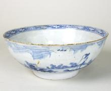 A Delft blue and white bowl, possibly London, 23cm diameter (restorations)