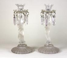 A pair of Baccarat glass lustres, each with figure frosted column on reeded circular base, both with impressed marks, 32cm high