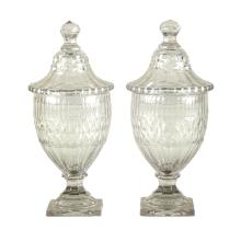 A pair of Irish glass lidded jars, cut with slices and diamonds, 29cm high/see illustration
