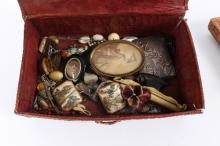 A quantity of costume jewellery contained in a stitched leather box and two carved wooden boxes