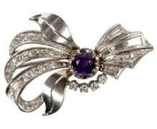 A diamond spray brooch, set a central round mixed cut purple gem with surround of baguette and brilliant cut diamonds, to an 18ct gold and platinum setting, 4.5cm long/see illustration
