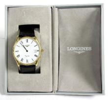 A Longines quartz wristwatch in a stainless steel case with a black leather strap