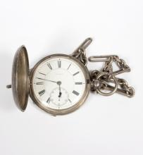 A silver cased pocket watch, London 1870, the enamelled dial with subsidiary seconds dial, T. Lewin, suspended on a silver belcher chain