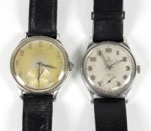 An Omega wristwatch, the subsidiary dial to a stainless steel case with a black leather strap and another Omega automatic wristwatch