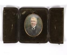 Attributed to Lucy Winifred MacDonald (1872-1951)/Portrait Miniature of George Muscott/watercolour on ivory, monogrammed LM, within a gilt metal frame and in a fitted leather case, frame 9.5cm x 7.5cm/and three black and white photographs of George Muscott aged 91, framed as one