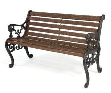 A garden bench with cast iron ends, the arms with lion mask terminals, 131cm wide