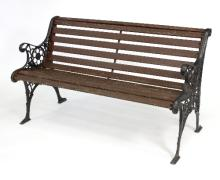 A garden bench with cast iron ends, with pierced rosette decoration, 127cm wide
