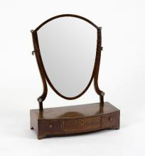 A 19th Century mahogany swing frame dressing mirror, the shield shaped plate on a bowfront base fitted three drawers, 46.5cm wide