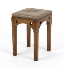 A square stool with upholstered top, the beech frame with pierced circles to the frieze, on square chamfered legs, 32cm wide and a mahogany swing frame dressing mirror on a turned skeleton support, 67cm wide