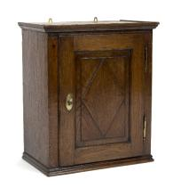 An early 18th Century oak hanging spice cupboard, with lozenge decoration to door, 60cm x 51cm