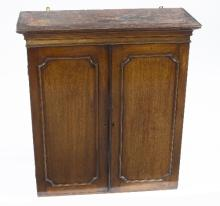 A mid 19th Century mahogany cupboard fitted adjustable shelves enclosed by a pair of fielded panel doors, 80cm wide