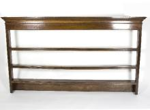 A 19th Century hanging shelf, with moulded cornice, 197cm wide
