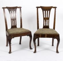 A pair of George I walnut single chairs with pierced splats and scrolling crest rails, the cabriole legs with shell and scroll carved knees, on pad feet