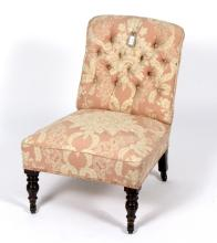 A late Victorian nursing chair with button-back on turned front legs